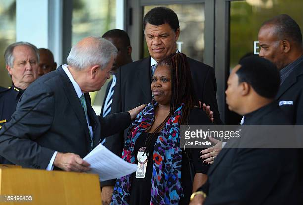 The City of Miami Mayor Tomas Regalado speaks with Carol Gardner whose son was killed by a shooter with an AK47 as they attend a press conference...