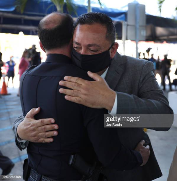 The City of Miami's new Police Chief Art Acevedo hugs an officer after his introduction at City Hall on March 15, 2021 in Miami, Florida. Acevedo is...