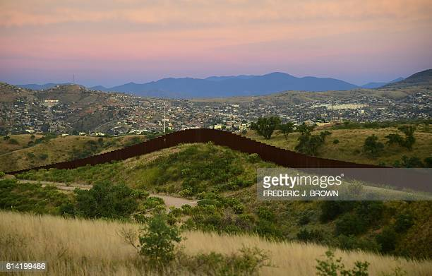 The city of Nogales in the state of Sonora on the Mexico side of the border is seen across the border wall from Nogales Arizona on October 12 2016 US...