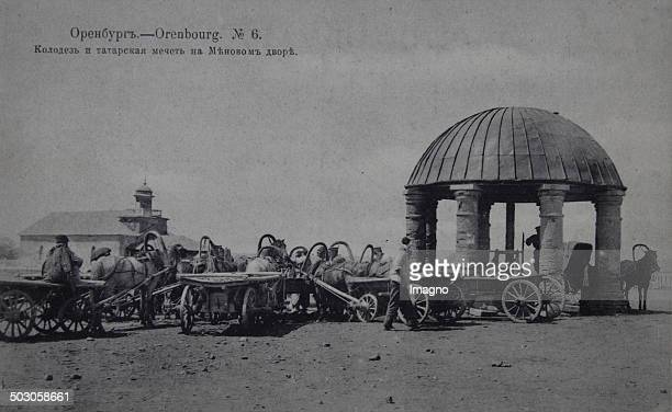 The city of Orenburg close to the border with Kazakhstan Tartar fountain with horses and carts 1914 Photographic postcard