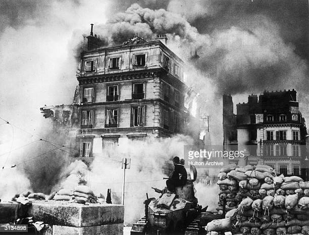 The city of Rouen is envoloped by smoke and fire during the German invasion of World War II.