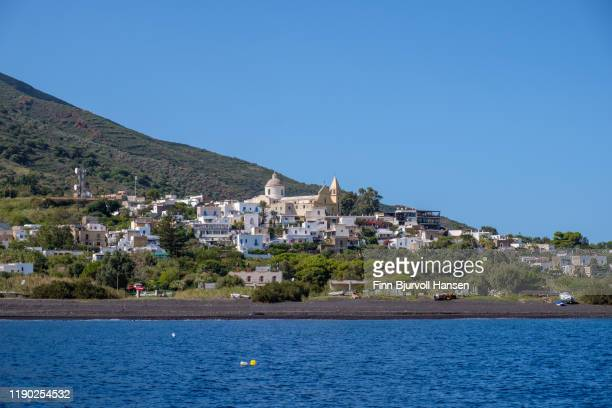 the city of san vincenzo at the volcanic island stromboli in italy - photographed from the seaside - finn bjurvoll stock photos and pictures