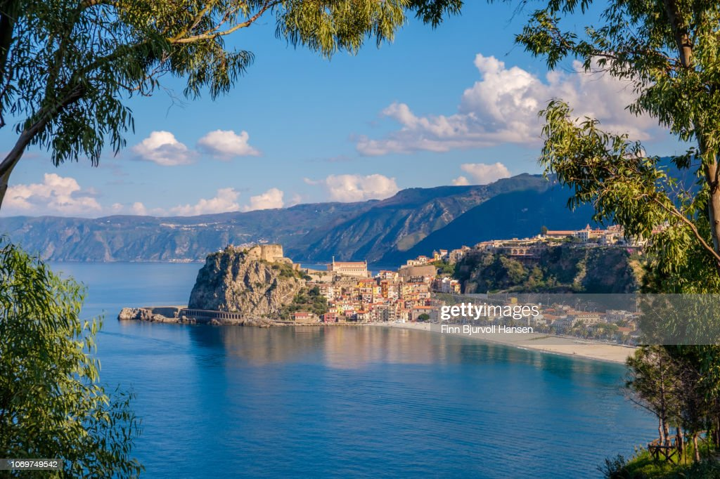 The city of Scilla in South Italy through a frame of branches : Stock Photo