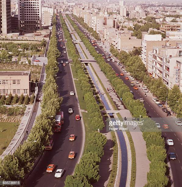 The city of Tehran Iran as seen from the Ministry of Agriculture building including Queen Elizabeth Street and Farah Park on the left