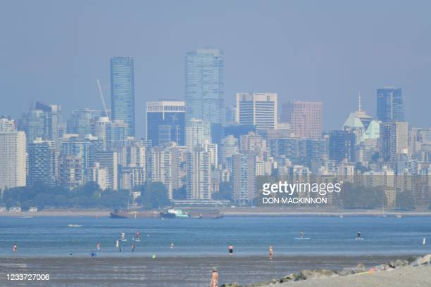 The city of Vancouver, British Columbia, is seen through a haze on a scorching hot day, June 29, 2021. - Schools and Covid-19 vaccination centers...