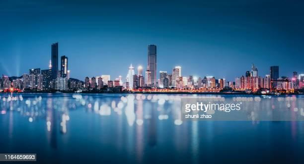 the city reflected on the sea - paisajes de china fotografías e imágenes de stock