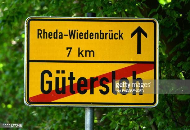 The city sign of Guetersloh is seen on June 23, 2020. - After a coronavirus outbreak at a slaughterhouse in the town of Rheda-Wiedenbrueck that has...
