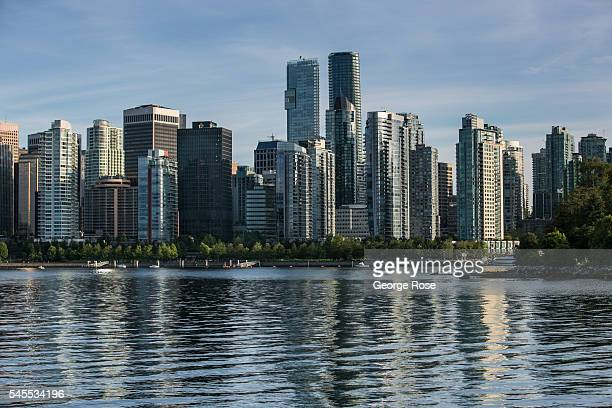 The city skyline and Coal Harbour is viewed in this late afternoon photo taken from Stanley Park on June 30 in Vancouver British Columbia Canada...