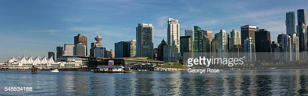 The city skyline and Coal Harbour is viewed in this panorama photo taken from Stanley Park on June 30 in Vancouver British Columbia Canada Vancouver...