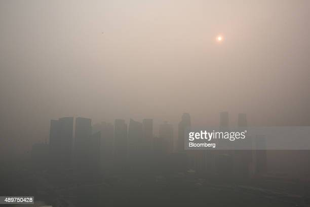The city skyline at Marina Bay as buildings in the central business district stand shrouded in smog in Singapore, on Thursday, Sept. 24, 2015. The...
