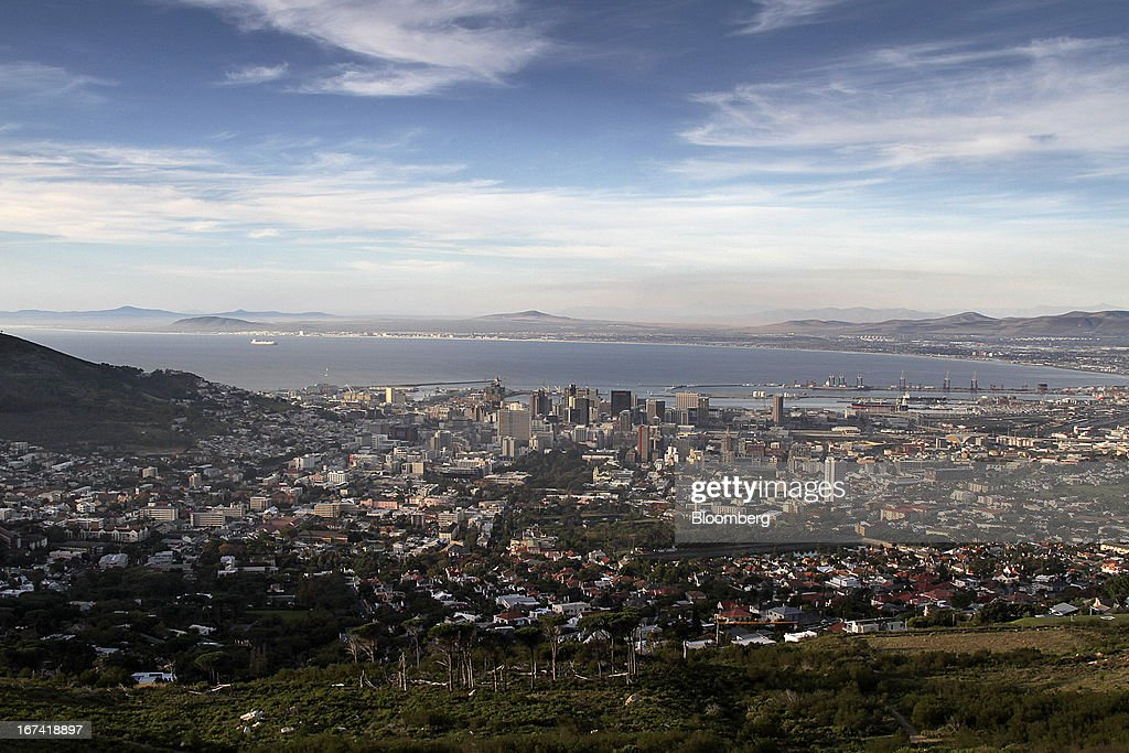 The city skyline is seen from Table Mountain in Cape Town, South Africa, on Wednesday, April 24, 2013. South Africa's gross domestic product is forecast to expand 2.6 percent this year, compared with 2.5 percent in 2012, according to the country's central bank. Photographer: Nadine Hutton/Bloomberg via Getty Images