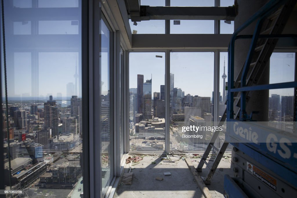 The city skyline is seen from unit during construction of the GWL Realty Advisors Livmore luxury apartment building in Toronto, Ontario, Canada, on Tuesday, July 10, 2018. Toronto's rental market is going upscale to meet surging demand from millennials and downsizing baby boomers who want a little more than your average walkup while providing a steady income stream for institutions such as pension funds. Photographer: Cole Burston/Bloomberg via Getty Images