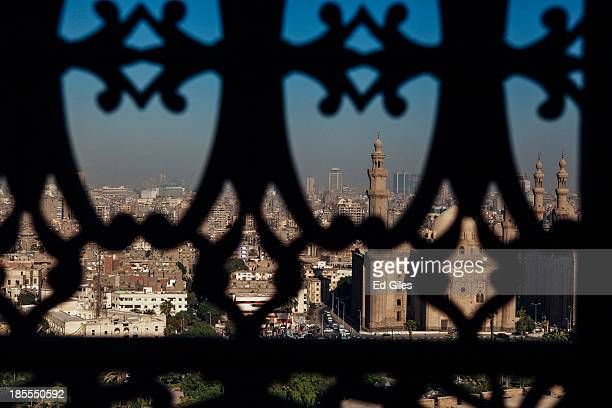 The city skyline of Cairo is seen through a window of the Muhammad Ali Mosque in Cairo's Citadel on October 21 2013 in Cairo Egypt The Muhammad Ali...