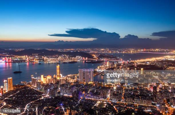 the city skyline of xiamen, fujian at sunset, the dotted urban architectural landscape lights are particularly beautiful - generic description stock pictures, royalty-free photos & images