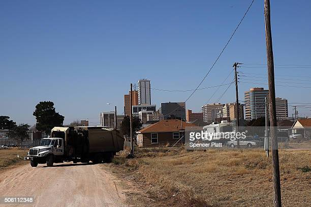 The city skyline rises beyond a residential area on January 21 2016 in the oil town of Midland Texas Despite recent drops in the price of oil many...