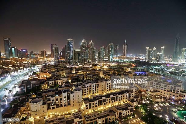 The city skyline sits illuminated at night in downtown Dubai United Arab Emirates on Friday Nov 7 2014 A year ago Dubai regulators took steps to cool...