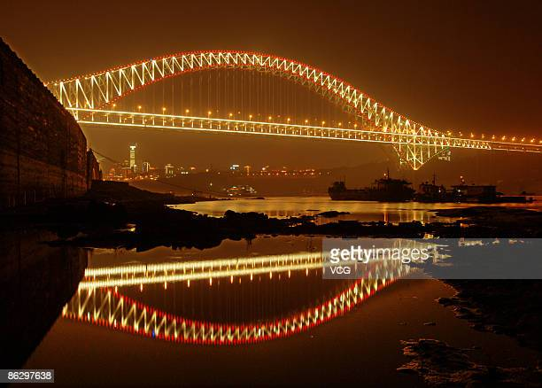 The city skyline stands beyond the Chaotianmen Bridge on April 29 2009 in Chongqing China The arch bridge with a new world record of 552 metres...