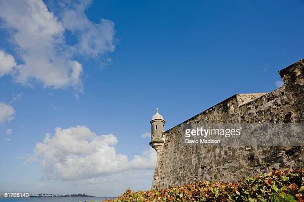 the city wall of old san juan, puerto rico.  guard tower is visible.  - old san juan wall stock photos and pictures