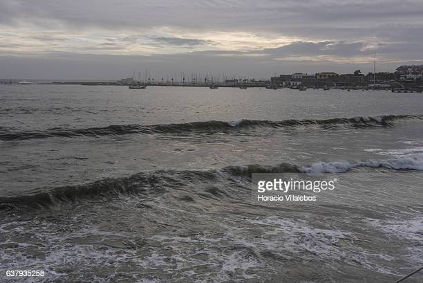 The city's harbor is seen as waves break at Praia da Duquesa in stormy weather on January 03 2017 in Cascais Portugal