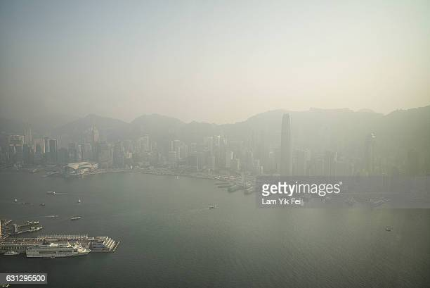 The city's skyline is seen over a haze of pollution on January 9 2017 in Hong Kong Air pollution rose to dangerous levels in Hong Kong on Sunday...