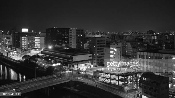 the cityscape of fukuoka during the night - 北九州市 ストックフォトと画像