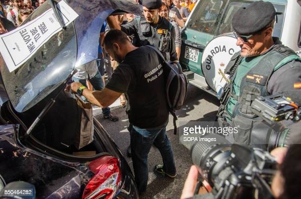 The civil guard confiscates documentation during the registration of the headquarters of Catalonia foreign affairs ministry Thousands of protesters...
