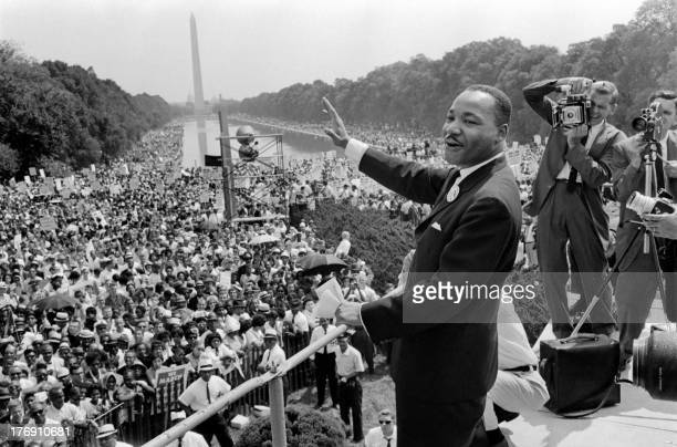 The civil rights leader Martin Luther King waves to supporters 28 August 1963 on the Mall in Washington DC during the March on Washington King said...