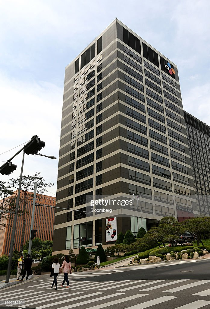 The CJ Group logo is displayed atop the company's headquarters in
