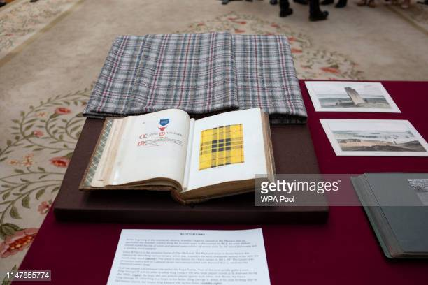 The Clan MacLeod tartan in reference to the President's mother Mary Anne MacLeod is seen in a book as Queen Elizabeth II US President Donald Trump...