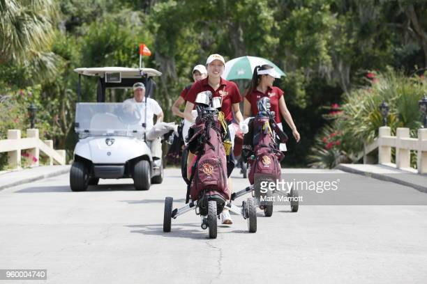 The Claremont Mudd Scripps team celebrates following overtime playoff action at the Division III Women's Golf Championship Williams College and...