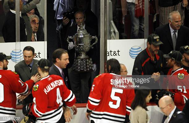 The Clarence S Campbell Bowl waits in the wings as Chicago Blackhawks celebrate 42 win over San Jose Sharks in Game 4 of the NHL Western Conference...