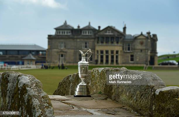 The Claret Jug sits by the Swilcan Bridge on the 18th fairway in front of the famous St Andrews club house building, during the Open Championship...
