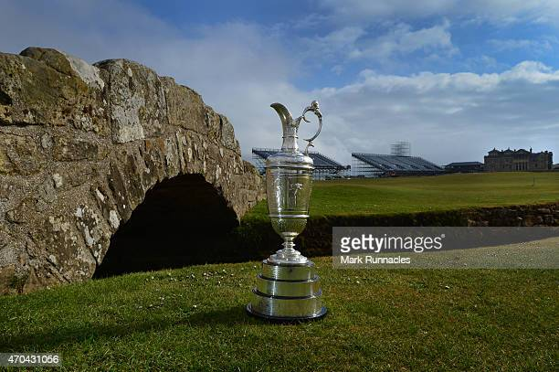 The Claret Jug sits by the Swilcan Bridge on the 18th fairway in front of the famous St Andrews club house building during the Open Championship...