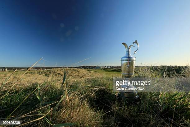 The Claret Jug the Open Championship trophy behind the second green during the media day for the 147th Open Championship on the Championship Course...