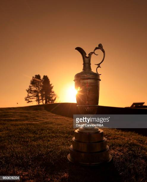 CAMERA The Claret Jug the Open Championship trophy in early morning light beside the 13th green during the media day for the 147th Open Championship...