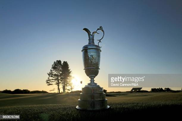 The Claret Jug the Open Championship trophy in early morning light beside the 13th green during the media day for the 147th Open Championship on the...