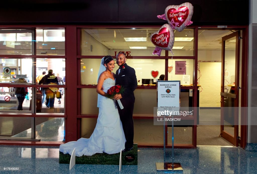 TOPSHOT - The Clark County Clerk's Office operates a temporary pop-up marriage license office at McCarran International Airport in Las Vegas on February 12, 2018. The Las Vegas airport has given new meaning to rushing to make a connection, offering quickie wedding licenses for lovebirds desperate to get hitched on Valentine's Day. Clark County, the authority that administers Sin City's weddings, has opened a pop-up marriage license bureau by a baggage carousel at McCarran International Airport. E. Baskow / TO GO WITH AFP STORY, 'Valentines get quickie marriage licenses at Las Vegas airport'
