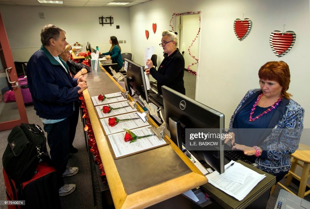 The Clark County Clerk's Office operates a temporary pop-up marriage license office at McCarran International Airport in Las Vegas on February 12, 2018. The Las Vegas airport has given new meaning to rushing to make a connection, offering quickie wedding licenses for lovebirds desperate to get hitched on Valentine's Day. Clark County, the authority that administers Sin City's weddings, has opened a pop-up marriage license bureau by a baggage carousel at McCarran International Airport. E. Baskow / TO GO WITH AFP STORY, 'Valentines get quickie marriage licenses at Las Vegas airport'