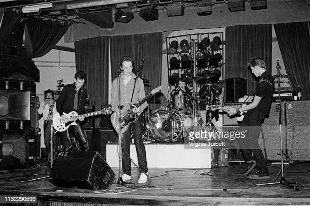 The Clash rehearse on stage at Notre Dame Hall, London, 6th July 1979. L-R Mick Jones, Joe Strummer, Topper Headon, Paul Simonon.