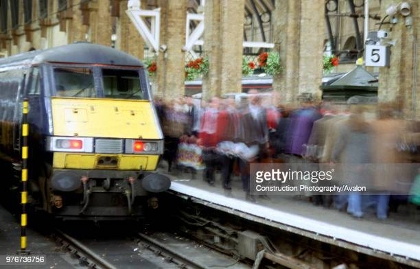 The Class 82/2 DVT at the Kings Cross buffers marks the arrival of a GNER service from the north as passengers hurry past on the busy platform United...