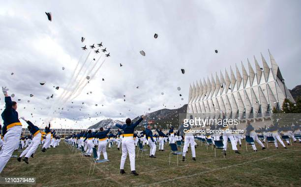 The class of 2020 toss their hats into the air as the Thunderbirds fly over on Saturday April 18 at the conclusion of the Air Force Academy...
