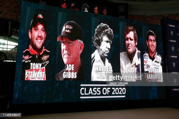 2019 The class of Tony Stewart Joe Gibbs Waddell Wilson Buddy Baker and Bobby Labonte are seen on a sign during the NASCAR 2020 Hall of Fame...