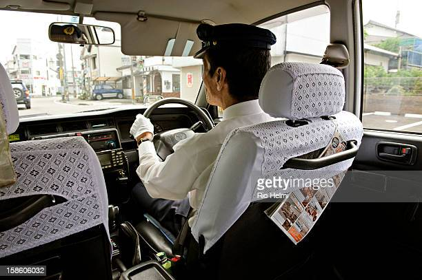 The classic Japanese taxi spotless covered in white automatic doors and driven by polite whitegloved chauffeurs can prove daunting at first for...