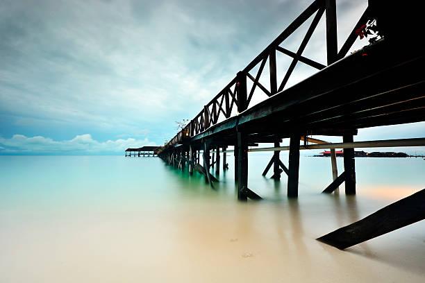 The clean beach with bridge