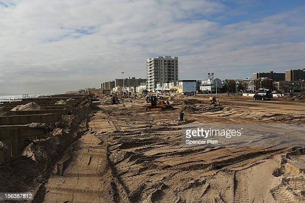 The clean up continues in the heavily damaged Rockaway neighborhood where a large section of the iconic boardwalk was washed away on November 14,...