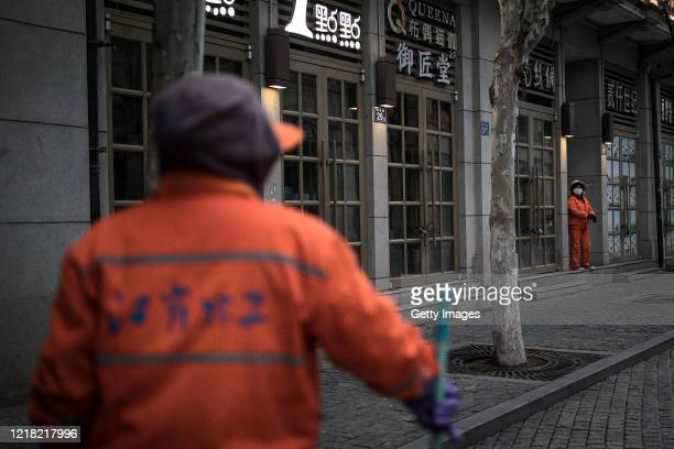 The cleaner is on duty in the street on April 11, 2020 in Wuhan, Hubei Province, China.he government started lifting outbound travel restrictions on...