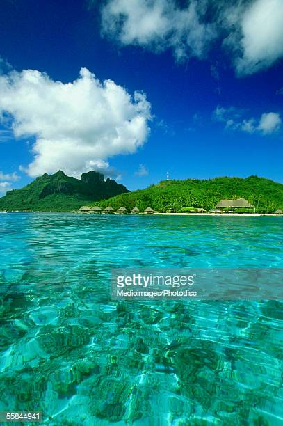 The clear South Pacific Ocean with bungalows, Bora Bora, French Polynesia