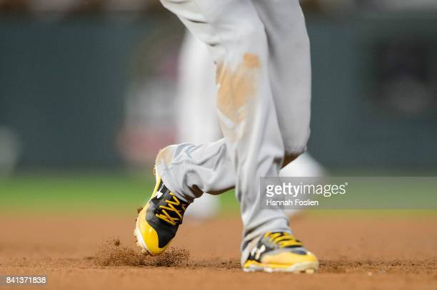 The cleats of Orlando Arcia of the Milwaukee Brewers are seen as he takes a lead off first base against the Minnesota Twins during the game on August...