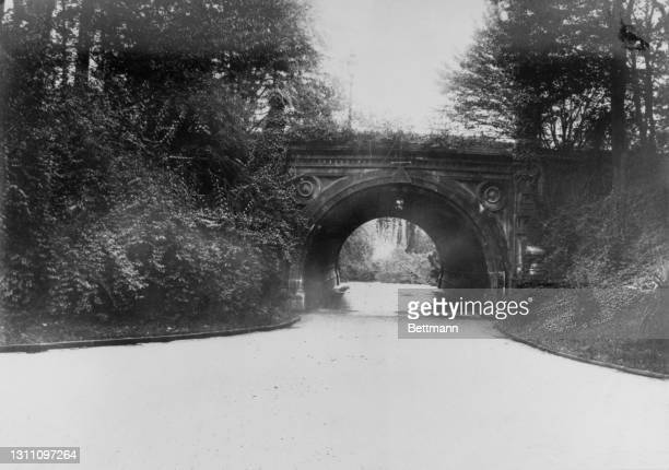 The Cleft Ridge Span, completed in 1872, in Prospect Park in the borough of Brooklyn, New York City, New York, 19th October 1902. The bridge, which...