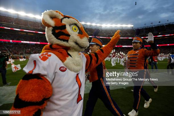 The Clemson mascot highfives band members before Clemson game against Alabama for the College Football Playoff National Championship at Levi's...
